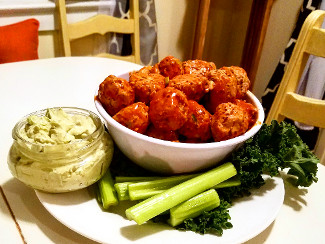 A platter with Buffalo Meatballs with Avocado Dipping Sauce.