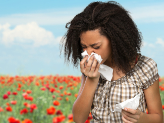 Woman suffering from seasonal allergies.